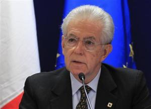 Italy's Prime Minister Mario Monti arrives at a news conference after a European Union leaders summit in Brussels